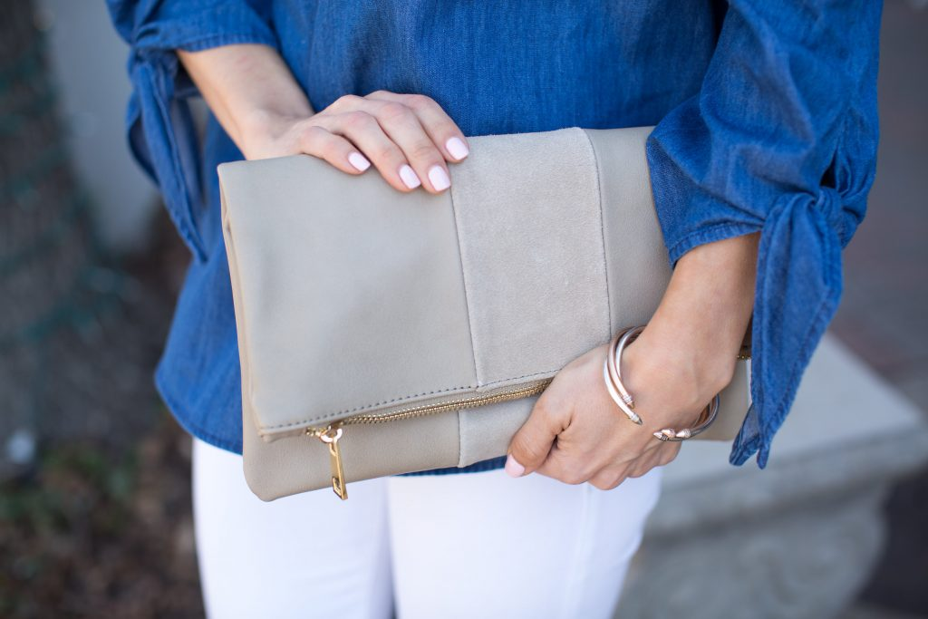 An Off Shoulder Chambray Top is an essential for spring. Pair it with your favorite White Jeans and open toe booties and you're ready to go! This Nude clutch is a great summer handbag, perfect for any occasion.