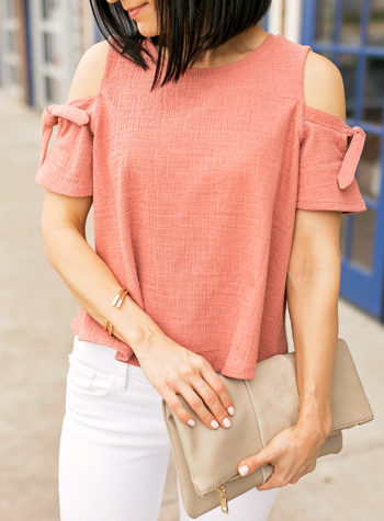 How to style white jeans and a cold shoulder top with nude block heel pumps.