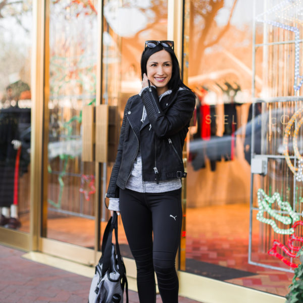 Active look with leather moto jacket and leggings, puma sneakers
