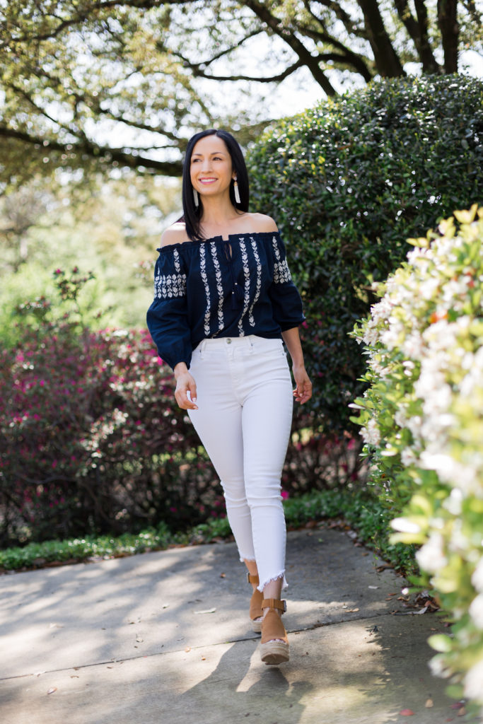 Off shoulder top and white jeans spring/summer outfit with Marc Fisher espadrilles and straw wicker circle handbag